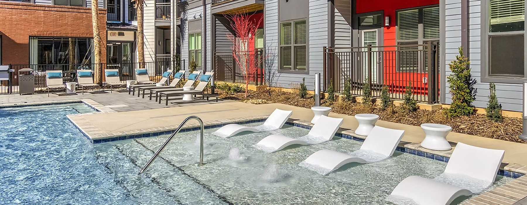 spacious swimming pool with in-pool recliner chairs