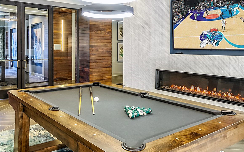 pool table in the spacious game room with high ceilings and ample room for relaxing
