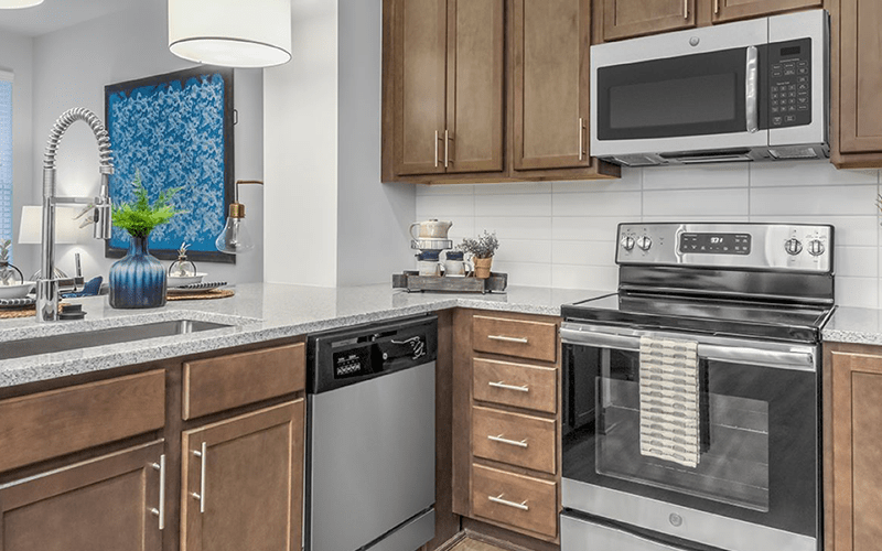 spacious kitchen on wood-style flooring and providing easy access to the living room
