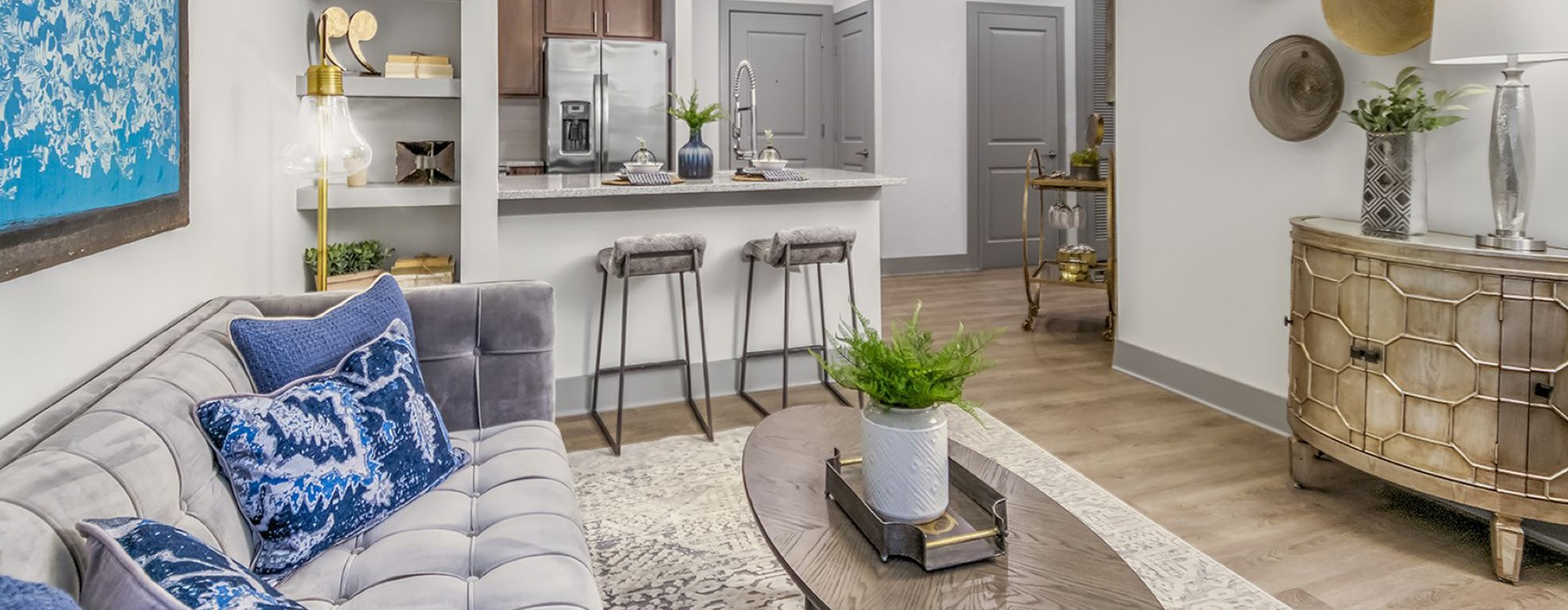 spacious living room with modern decor and providing easy access to the kitchen area