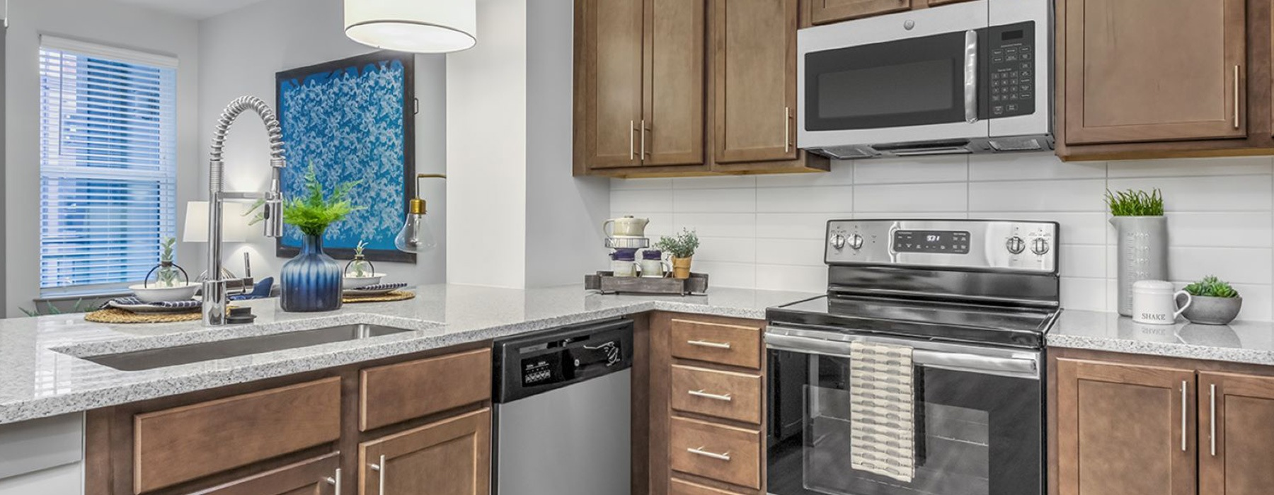 spacious kitchen with easy access to the living room